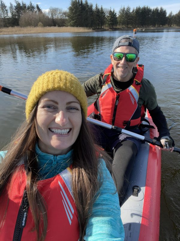 Anne Johnston and JP Bell kayaking on a red Gumotex Solar inflatable kayak on Forfar Loch