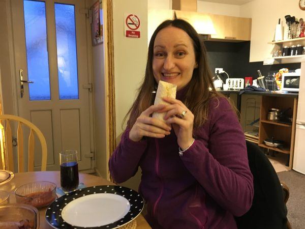 Anne Johnston eating fajitas on brain injury anniversary