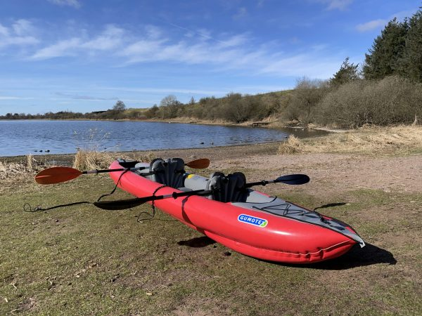 A red Gumotex Solar inflatable kayak at Forfar Loch