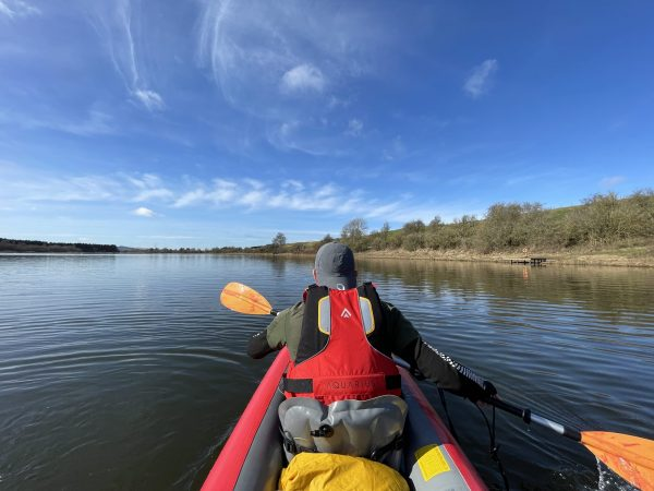 JP Bell kayaking on Forfar loch on a red Gumotex Solar inflatable kayak